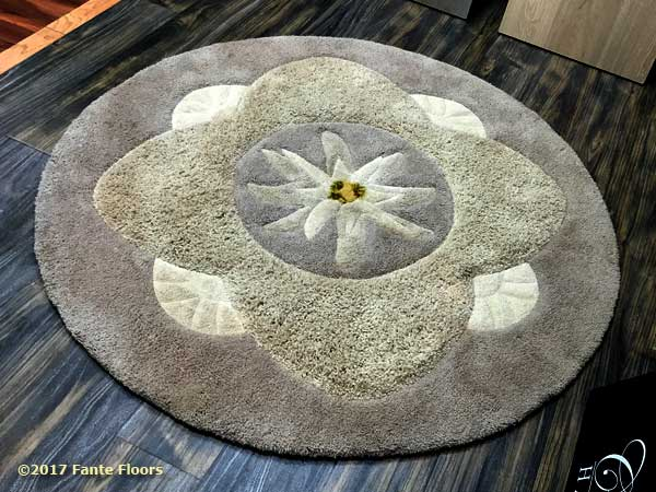 Custom cut lotus blossom area rug by Fante
